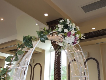Flower and Light Arch at Wedding